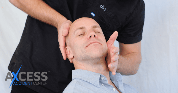 chiropractor adjusting someones neck